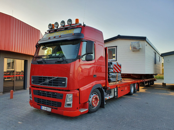 How are mobile homes transported?