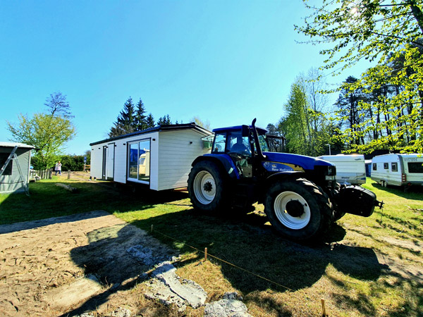 Putting the home on land using a tractor