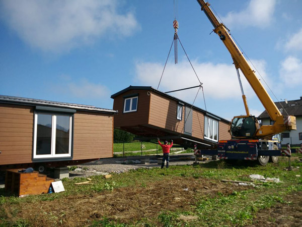 Putting the home on land using a crane
